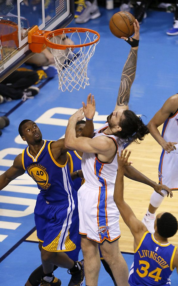 Oklahoma City\'s Steven Adams (12) goes up for a basket as Golden State \'s Harrison Barnes (40) defends during Game 4 of the Western Conference finals in the NBA playoffs between the Oklahoma City Thunder and the Golden State Warriors at Chesapeake Energy Arena in Oklahoma City, Tuesday, May 24, 2016. Photo by Sarah Phipps, The Oklahoman