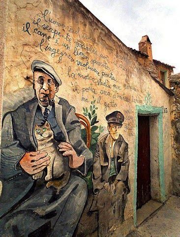 ORGOSOLO, ITALY   l   Pablo Neruda depicted on a wall in Sardinia. The area is known for its murales (political paintings).