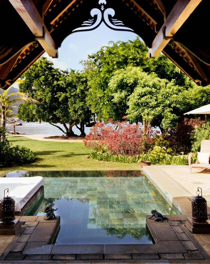 Lush tropical gardens surround Maradiva Villas in Mauritius