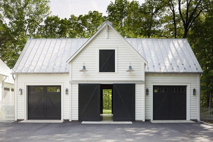 White Horizontal Siding And Black Garage Doors Farmhouse Barn Exterior Garage Exterior Farmhouse Garage Barn Garage