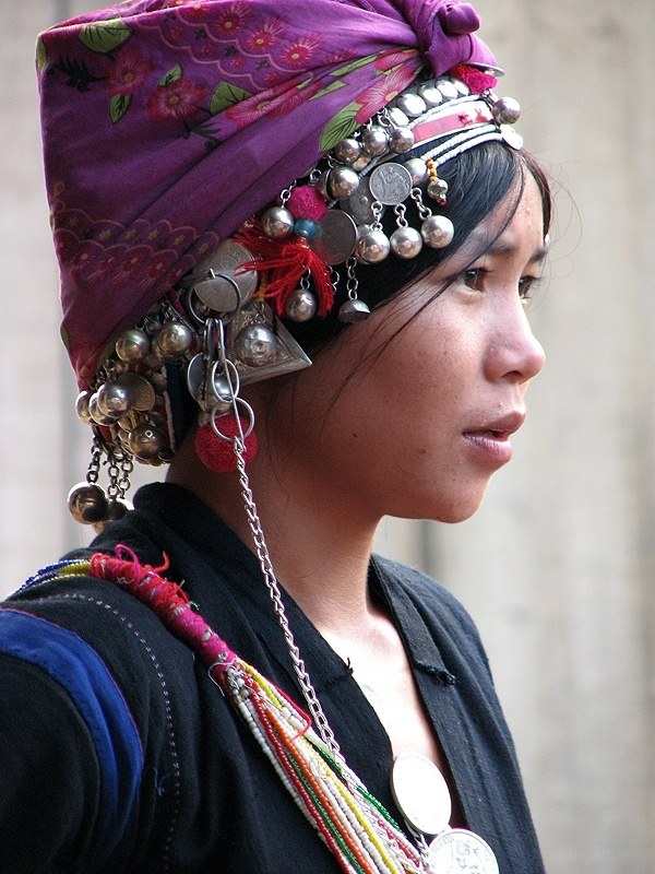 Portrait of a young Akha woman with a headscarf and traditional headdress, Muang…