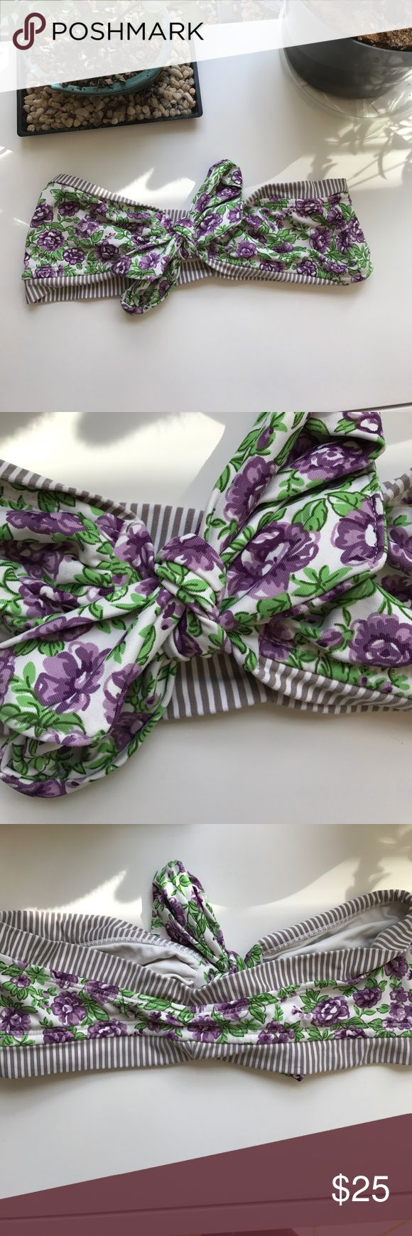 Anthropologie tie bandeau swim top Super cute bandeau bikini top from anthropologie. Brand: SAHA. Size large but fits a medium as well since it is adjustable. Purple flowers with green leaf design and white and brown/tan stripes Anthropologie Swim Bikinis