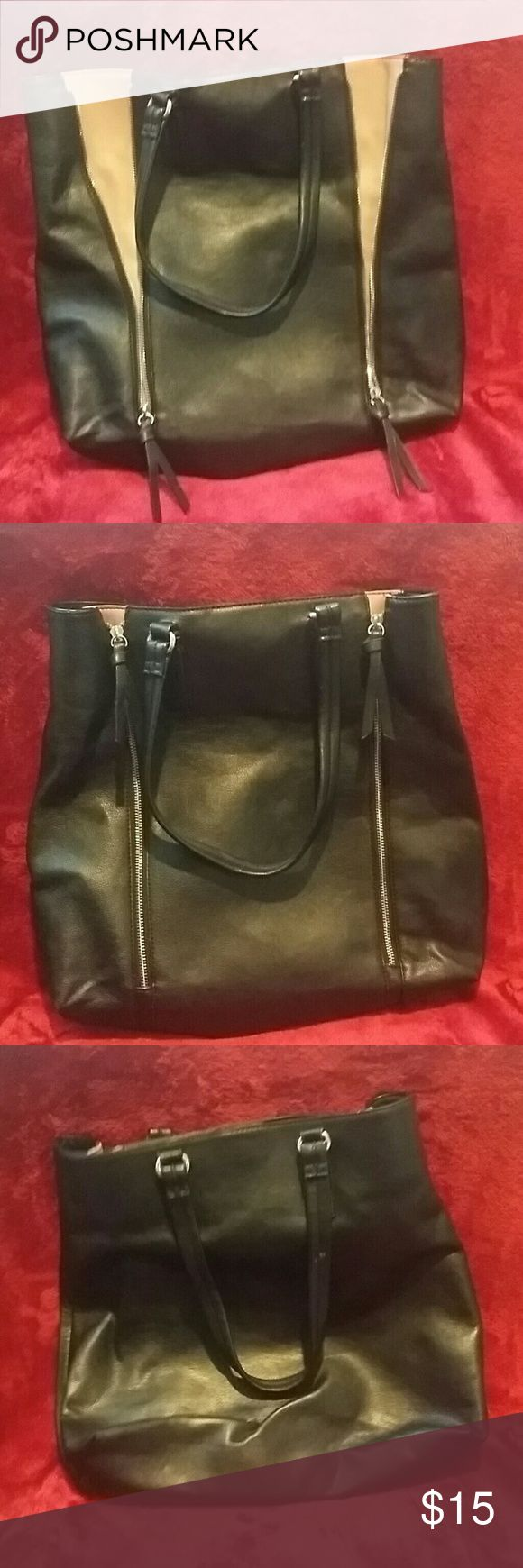 Aldo tote Black & tan Aldo tote| worn a few times  PRICE IS FIRM, UNLESS BUNDLE DISCOUNT APPLIED Aldo Bags Totes