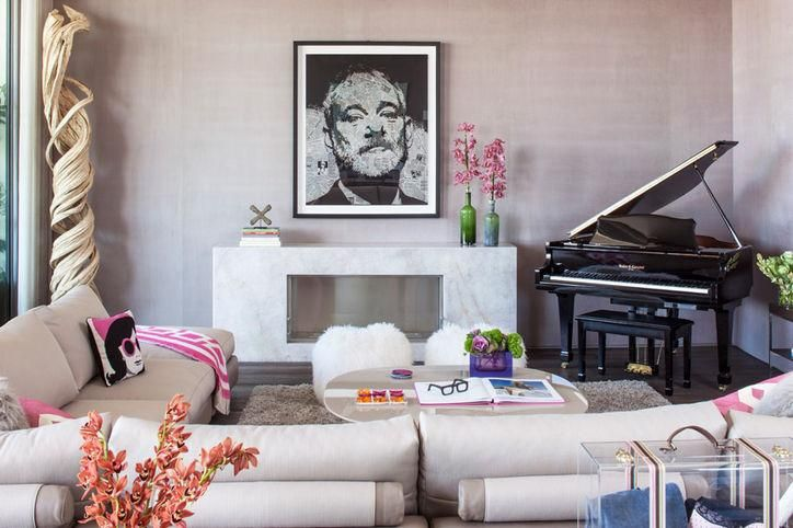 Barbie dream house: Suede wallpaper, a stone fireplace, and a Bill Murray artwork by Gregory Auerbach complete the room.