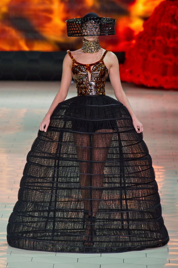This Alexander McQueen S/S 2013 look clearly mimics the look of the 18th century pannier. Mcqueen, per usual, put an amazing cool modern spin on some a dramatic historical garment.