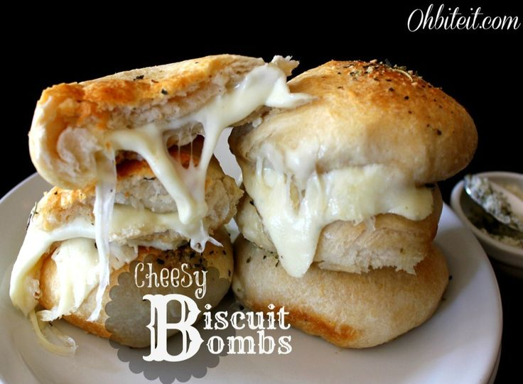 Cheesy Biscuit Bombs: 1 Container of Pillsbury Grands Flaky Layers Biscuits 3/4 lb Mozzarella 1/4 cup Olive Oil 1/4 cup Grated Parmesan 1 tsp. Oregano/Italian Seasoning Bake 350 for 15-20min
