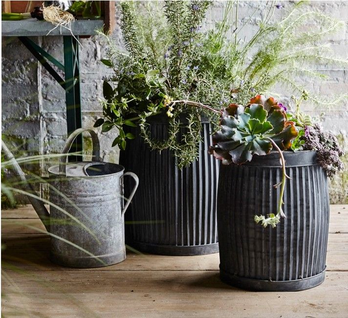 Fluted zinc Planters, Gardenista  Above: For US shoppers, Vence Planters are available in two sizes (with diameters of 12.5 inches of 16 inches) and are sold in pairs; they are available for $79.95 and $99.95 respectively from Williams-Sonoma. Color and wax are applied to the ribbed surfaces to make them look aged.