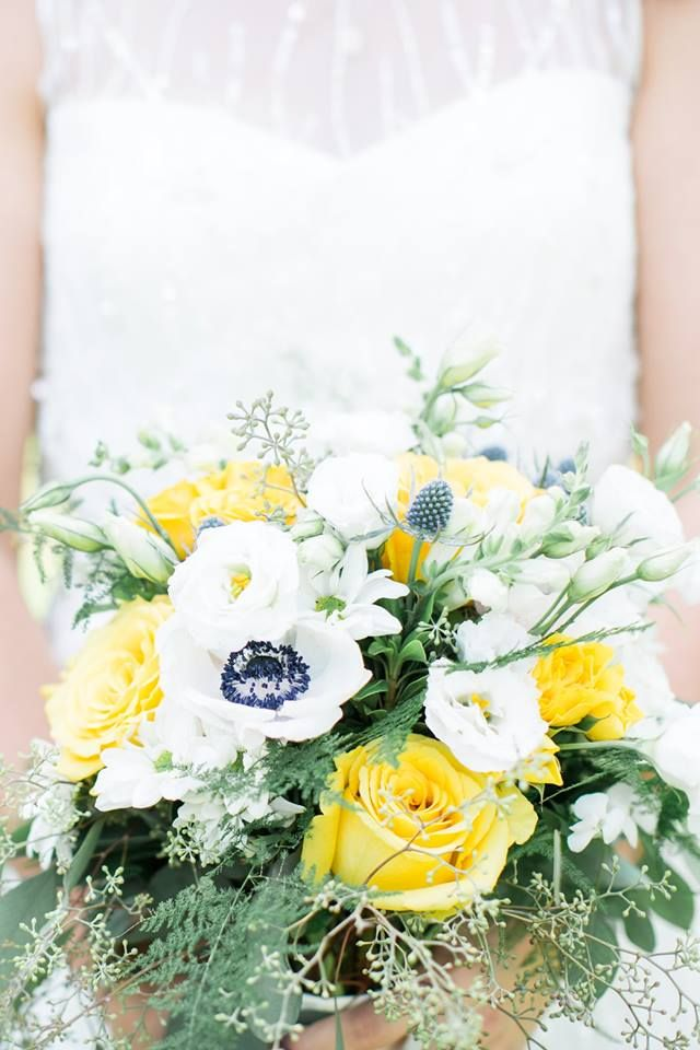 Dreamy summer bridal bouquet created by Peony House Floral Studio.  Anemone, fern, lisianthus, yellow roses, blue eryngium, white spray roses, snapdragons, seeded eucalyptus...