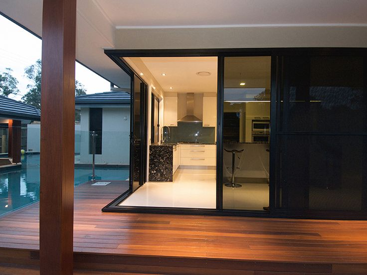 Corner sliding glass door mediterranean modern for Corner sliding glass doors