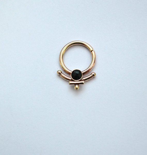 This ring that wants to embrace you. | 21 Unconventional Septum Rings That You…