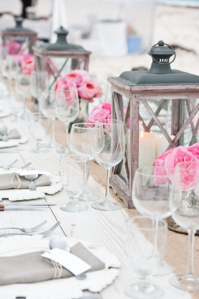 love the lanterns mixed with vases of roses for a splash of color....could use any flower or color to change it up.....burlap runner.....white wood chargers make for a pretty place setting. Perfect for a wedding, dinner party, anniversary, birthday, any celebration. Beach house decor, upscale coastal, timeless.