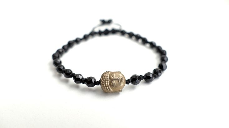 Macrame bracelet from Black Onyx and the symbol of Buddha from gold plated Hematite -Price:15€