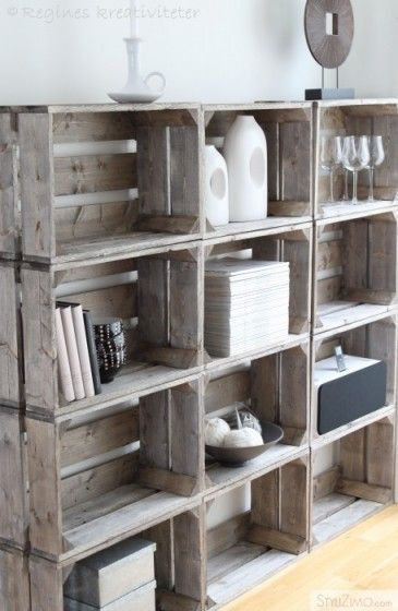 Easy industrial shelving! Crates weathered to look old, then stacked or hung together. For extra interest, add metal hardware at the corners.
