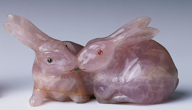 Provenance: Probably acquired by Queen Alexandra; Royal Collection by 1953. Description: Two rabbits, rose quartz, eyes inset with cabochon sapphires and rubies. Cartier. c.1900
