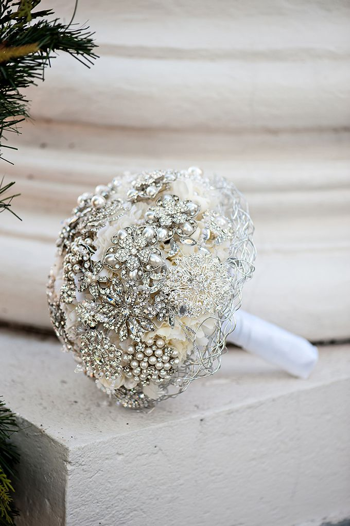 silver and white brooch bouquet. It'll last longer than flower boquets and its very pretty but I think I prefer the natural flowers