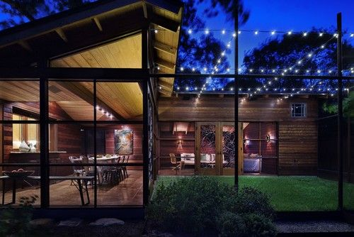 Backyard lighting:  eclectic porch by Vivid Design Group