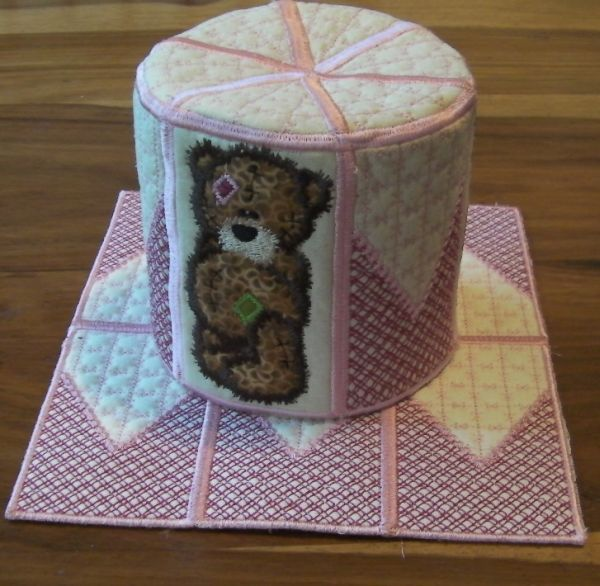 ITH Tatty toilet roll cover by JHB Creations.  Designs available here http://www.oregonpatchworks.com/items.php?did=113482&pid=1587439