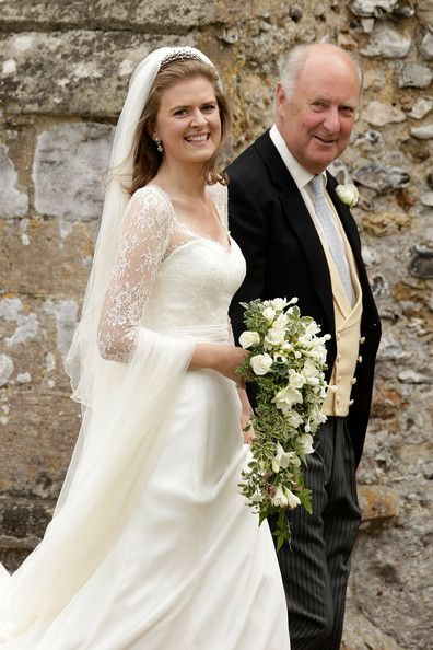 Lady Laura Marsham with her father arrives for her wedding to James Meade at St Nicholas church in Gayton on 14 Sep 2013 in King's Lynn, England