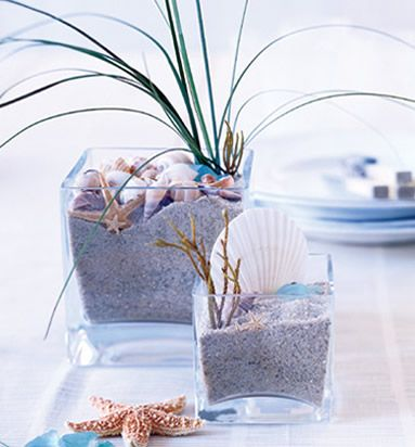 Sand & shell centerpiece--this is what I was thinking of --with candles set in to them... For The Bathroom?