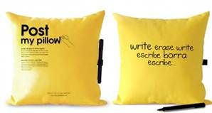 It's a post it pillow! Write what you need to remember in the morning. I wonder if the marker gets on your face?