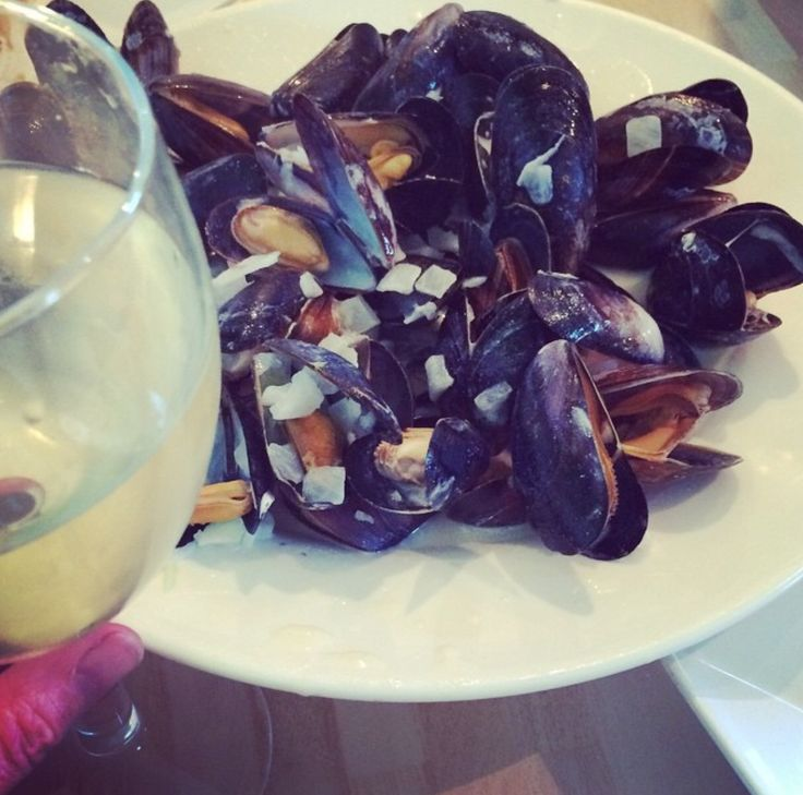 I absolutely love this dish   :My Own recipe:  Mussels in Chardonnay sauce .Fresh bag of mussels/garlic/chopped shallots/creme fresh/pinch of sea salt & cooked in a large glass of Chardonnay white wine, with a large glass to go with it ;-) obviously lol. This is great on its own or served with some crusty bread!