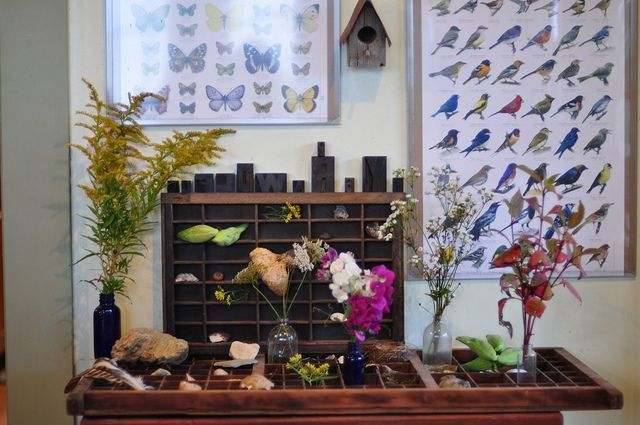 Use a wooden soda crate to display treasures on a nature table.