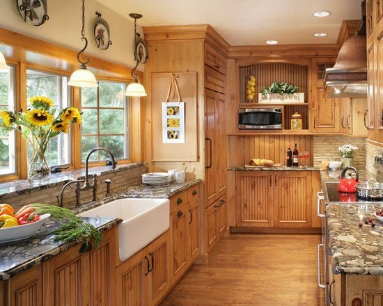 Decoration, Astounding Knotty Pine Kitchen Cabinets With Bowl Of Paprika And Bunch Of Yellow Flowers Also White Washbasins And A Stack Of Dinner Plates Featuring Light Brown Pine Kitchen Cabinet And Patterned Marble Kitchen Table: Ideas of Knotty Pine Cabinets