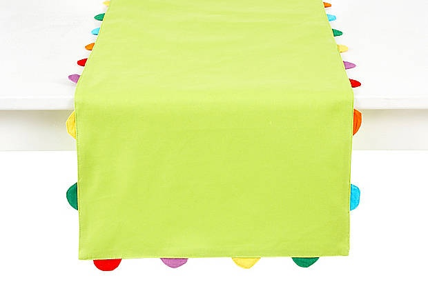 make this NOW sister. because you don't need an occasion to make everyone feel special. upholstery fabric (cause it's thicker), a tad longer than your table. your kids help cut out scraps to go around in festive colours. pin & sew.  an hour tops.  tag party confetti table runner.