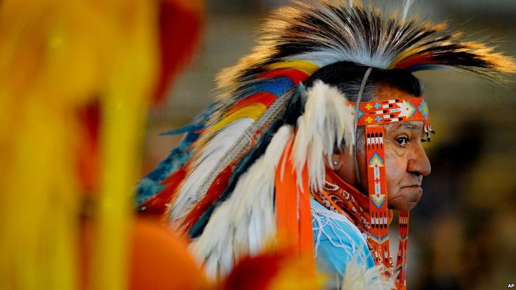 Native Americans Call For Rethink of Bering Strait Theory.  Butch McIntosh wears traditional Native American regalia at the Pow Wow of Champions on the fairgrounds in Tulsa, Okla. Saturday Aug. 11, 2007.