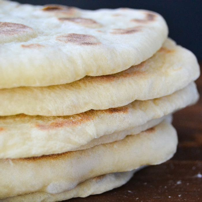 a stack of freshly baked homemade pita bread