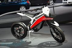 BMW unveils concept Husqvarna electric motorcycle. Would take far less electricity than even the smallest electric car, and looks pretty cool too!