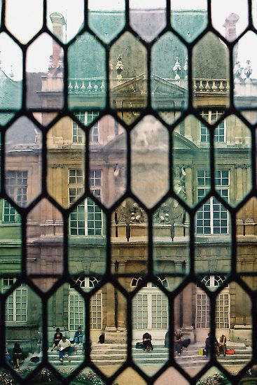 City scenes through stained glass.