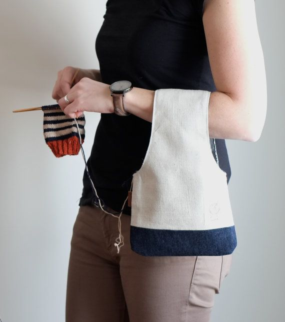 A project bag to put on your wrist...  It makes your projects portable so you can knit anywhere, at the bus stop, in a waiting room and obviously at