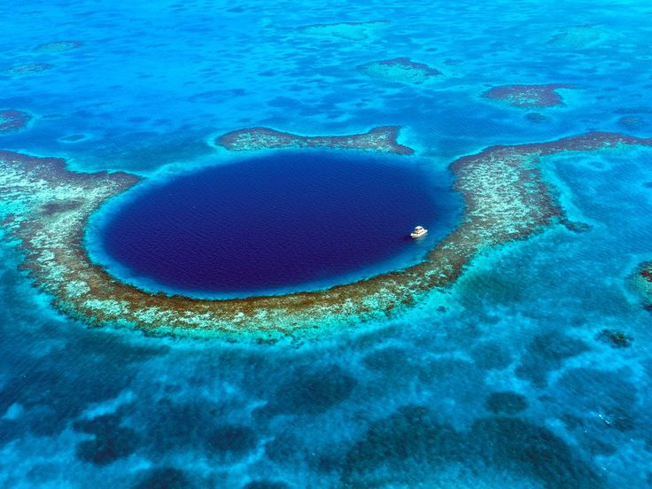 Known for its circular shape and strikingly deep blue color, the Great Blue Hole is a 1,000-foot-wide sinkhole in the middle of Belize's Lighthouse Reef. While an aerial shot is enough to convince anyone of its beauty, scuba divers are the ones who get to experience the wonders that lie beneath—massive limestone stalactites and stalagmites that formed during the last glacial period.