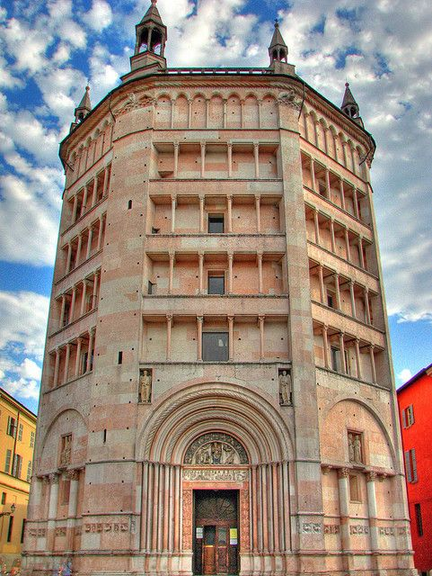 The Baptistery of Parma,Italy 1196. Constructed of pink marble and octagonal in shape. It marks the exact transition from the Romanesque to the Gothic style.