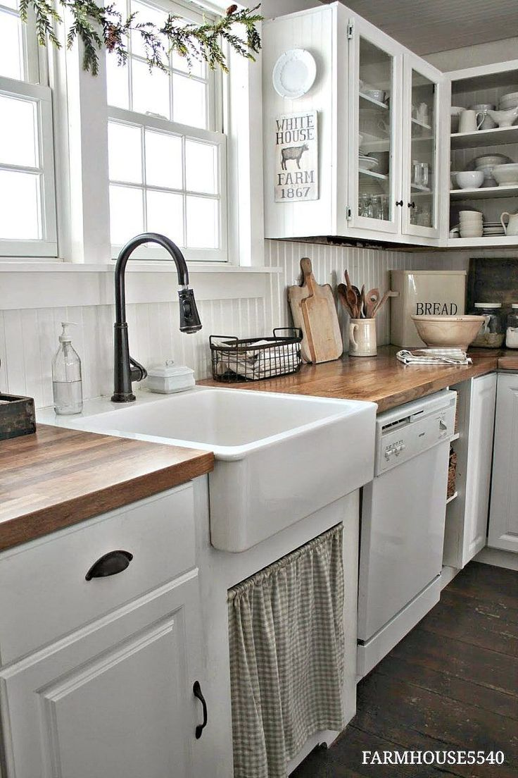 Butcher block and white cabinets is nice. Don't care for the curtain under the sink, and would still prefer some kind of tile backsplash over wood.
