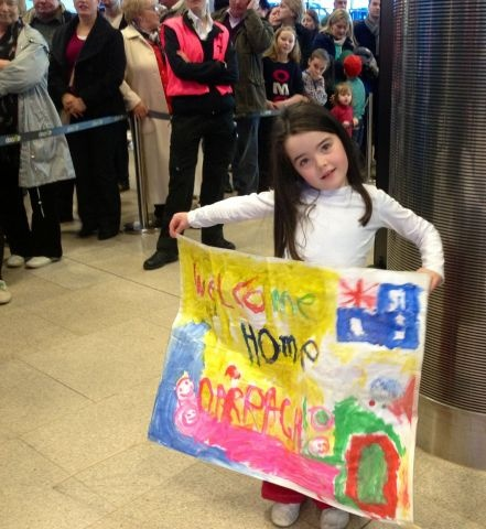 Anna with her Welcome Home banner for Darragh traveling from Australia to Mayo via Dublin. http://www.dublinairport.com/gns/at-the-airport/latest-news/12-12-11/Christmas_Twitter_Instagram_Photo_Competition.aspx