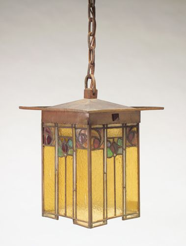"GUSTAV STICKLEY: Rare and exceptional four-sided lantern with an overhanging hammered copper top on panels of hammered amber leaded glass, depicting stylized flowers in reds and greens. Original patina, some looseness to corners. Complete with original chain and square ceiling cap. Circular Craftsman stamp. Lantern: 13"" x 10 1/4"" x 10 1/4"", with chain: 37 1/2"" ht."