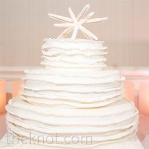 White Starfish-Topped Wedding Cake: Classic, Simple and Beach-y all at the same time!