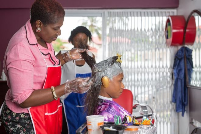 Why Ghana's natural hair fashion is bad for business By Rebecca Tsotsoo Kwei BBC News, Accra, Ghana