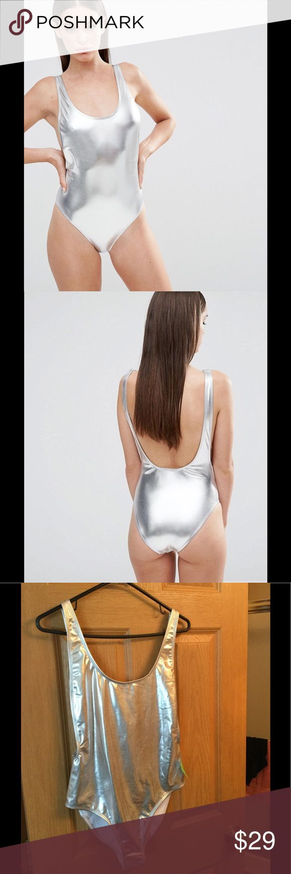 Missguided High Leg Drop Arm Swimsuit Silver Metallic Silver NWT. Tiny scuff at the back bottom area . Too small to notice and can't capture on camera . ASOS Swim One Pieces