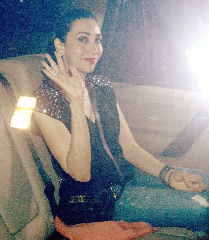Karisma Kapoor waves to the media and fans at Shakeel Ladak's birthday bash. #Bollywood #Fashion #Style #Beauty