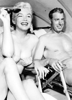 Marilyn Monroe & Joe DiMaggio.. he cared enough to come to her aid any time she called him, cared for her after she died.  He put roses on her grave twice a week for 20 years after she died.  Thats love!!!!!!!