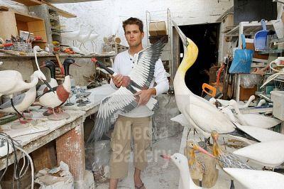 Grégoire Bonin making papier-mâché bird, Saint-Martin-de-Ré, Île de Ré, Atlantic Coast. Charente-Maritime, Poitou-Charentes, France