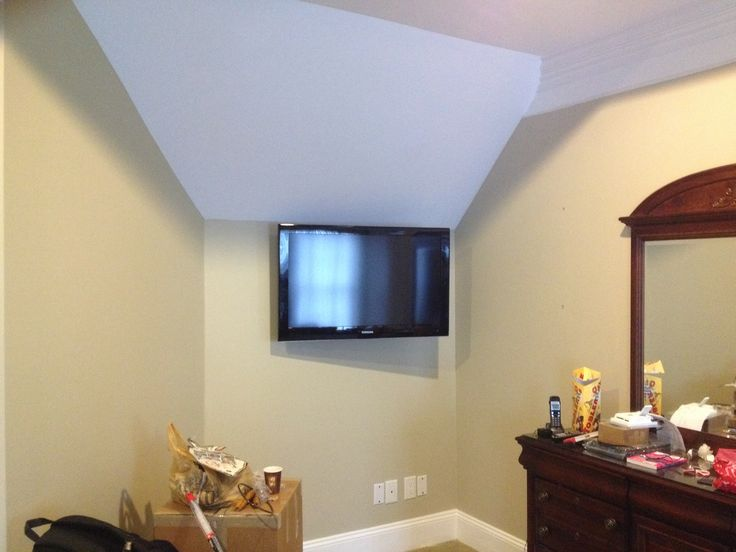 "50"" Samsung TV full motion wall mount installation in master bedroom Charlotte Home Theater Installation. http://hometheatercharlotte.net Speaker installation, flatscreen TV wall mounting 704-905-2965"