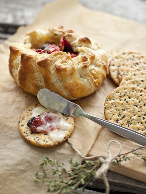 Baked brie with sun dried tomatoes in puff pastry.