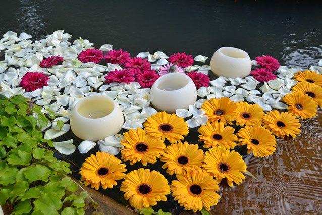 velas flotantes con flores