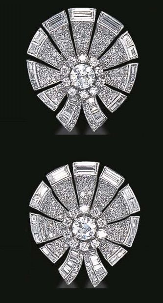 AN ELEGANT PAIR OF ART DECO DIAMOND EAR CLIPS, BY VAN CLEEF & ARPELS. Each designed as a pavé-set diamond circular spray, enhanced by baguette-cut diamond trim, centring upon an old European-cut diamond within a circular-cut diamond surround, mounted in platinum, (may be worn as dress clips), circa 1935. Signed Van Cleef & Arpels, NY, numbered.