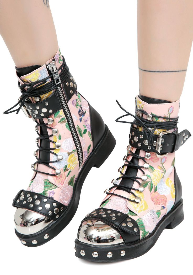 Current Mood Rosie Floral Combat Boots will keep ya sweet while you're kickin' their azz! These cute N' grungy combat boots have an embroidered floral print with silver stud details and an inside zipper closure.