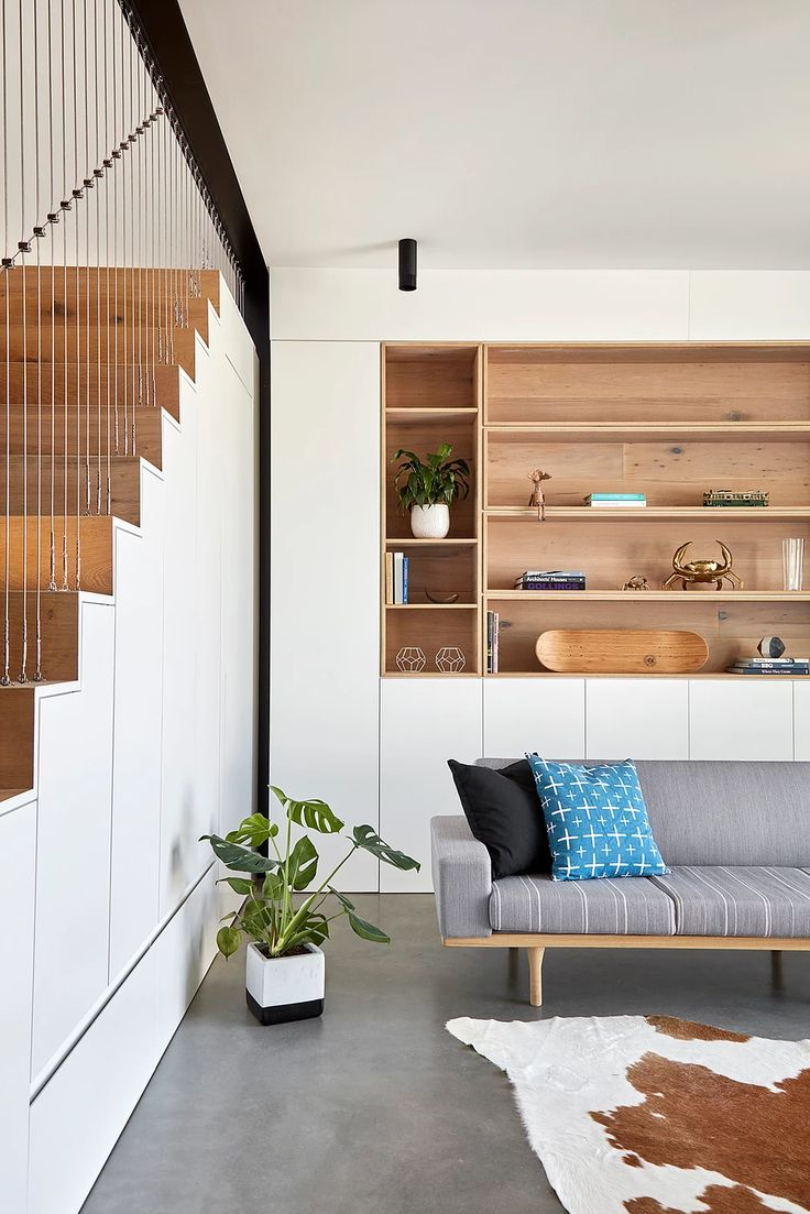 Mark St, Fitzroy North Living room, stair, under stair joinery, cable wire handrail, concrete floors, hidden doorway, timber joinery